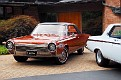 10 1963 Chrysler Ghia Turbine Car with 1963 Dodge Polara front view at sixties-era modern home