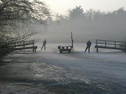Skaters in the fog