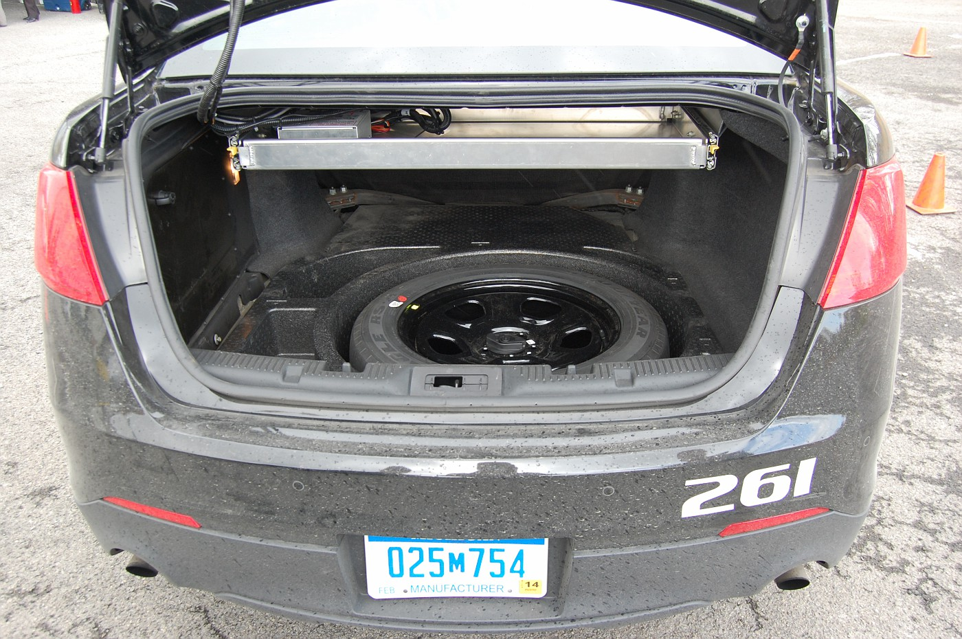 Trunk with liner removed to show added steel bracing for 75mph crash protection