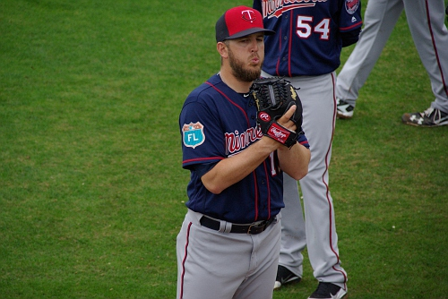 IMGP9830.JPG-Tom Kelly imparts some wisdom on playing first base to Mauer, Vargas and Park (and his interpreter)