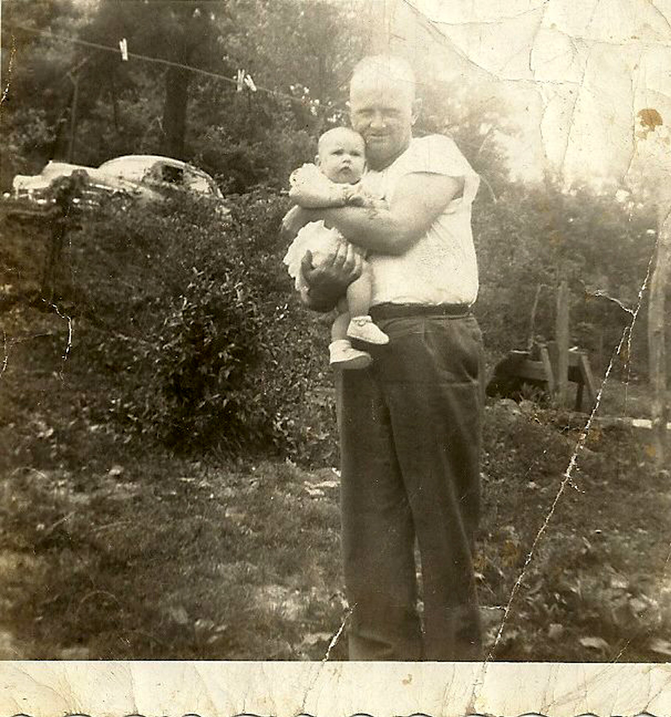 2 - Wiley Gibson (1914-1999), and the baby may be a son or daughter.